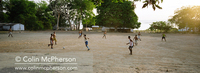Villagers playing football at dusk in the village of Jaguarari on the banks of the Tapajos river. The Floresta Nacional do Tapajos (FLONA), a 6500 km2 protected reserve, was home to several small communities which lived on the banks of the Rio Tapajos. The communities did not have electricity or running water and access to the villages was by unpaved dirt roads from Santarem and Highway BR163.
