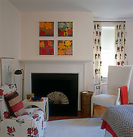 Fireplace and comfortable armchairs in a small bedroom