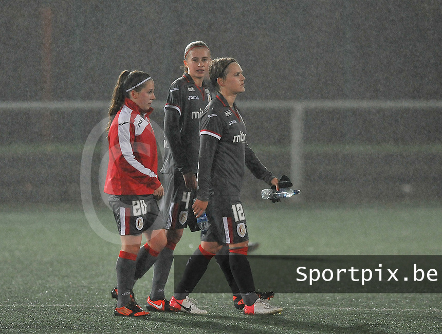 20131017 - GLASGOW , SCOTLAND : disappointment  pictured after the 3-1 loss from Standard against Glasgow with Standard players Taika De Koker (left) , Julie Biesmans (middle) and Julie Gregoire after the female soccer match between GLASGOW City Ladies FC and STANDARD Femina de Liege , in the 1/16 final ( round of 32 ) second leg in the UEFA Women's Champions League 2013 in Petershill Park in Glasgow. First leg ended in a 2-2 draw . Thursday 17 October 2013. PHOTO DAVID CATRY