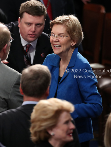United States Senator Elizabeth Warren (Democrat of Massachusetts) in discussion with her colleagues prior to US President Donald J. Trump delivering his second annual State of the Union Address to a joint session of the US Congress in the US Capitol in Washington, DC on Tuesday, February 5, 2019.<br /> Credit: Alex Edelman / CNP