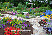 63821-21720 Blue bench, blue pots, butterfly house, bird bath and stone path in flower garden.  Black-eyed Susans (Rudbeckia hirta) Red Dragon Wing Begonias (Begonia x hybrida)  Homestead Purple Verbena (Verbena canadensis), Red Verbena, New Gold Lantana (Lantana camara) Butterfly Bushes, Russian Sage (Perovskia atriplicifolia), Moon vine on trellis  Marion Co., IL