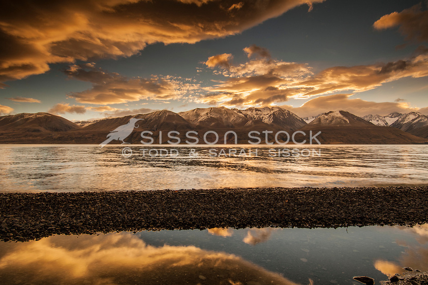 Sunset photo of sunset clouds reflected in Lake Pukaki, Mackenzie country, New Zealand.