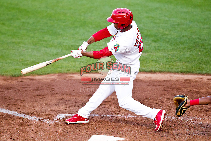 Oscar Taveras (25) of the Springfield Cardinals swings at a pitch during a game against the Arkansas Travelers at Hammons Field on May 5, 2012 in Springfield, Missouri. (David Welker/Four Seam Images)