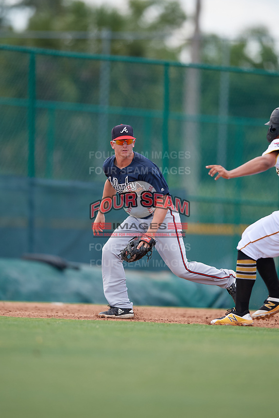 GCL Braves third baseman Cade Bunnell (25) looks to tag a base runner during a Gulf Coast League game against the GCL Pirates on July 30, 2019 at Pirate City in Bradenton, Florida.  GCL Braves defeated the GCL Pirates 10-4.  (Mike Janes/Four Seam Images)
