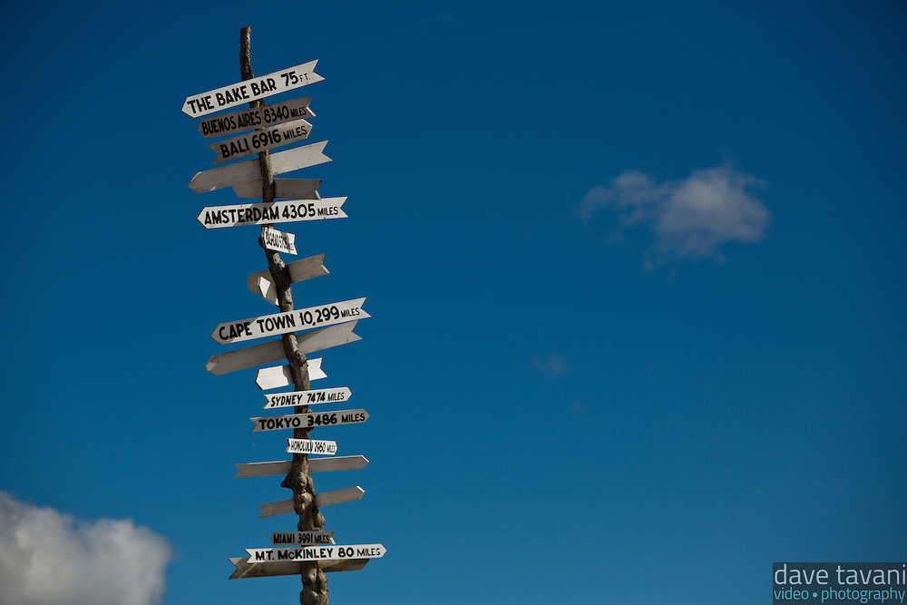 This sign shows the distances to several places around the world, including Mt. McKinley.
