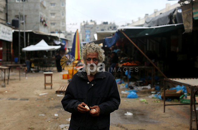A Palestinian man poses for a photograph at the market in Shati refugee camp in Gaza city on Jan. 07, 2016. Photo by Ezz al-Zanoun