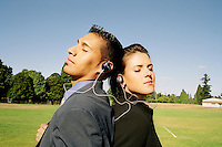 Business couple enjoys music in a park..MR