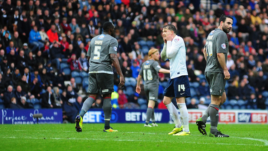 Preston North End's Joe Garner shows his frustration at missing a chance in the second half<br /> <br /> Photographer Chris Vaughan/CameraSport<br /> <br /> Football - The Football League Sky Bet League One Play-Off First Leg - Preston North End v Rotherham United - Saturday 10th May 2014 - Deepdale - Preston<br /> <br /> &copy; CameraSport - 43 Linden Ave. Countesthorpe. Leicester. England. LE8 5PG - Tel: +44 (0) 116 277 4147 - admin@camerasport.com - www.camerasport.com