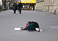 Woman lying in the street begging Paris..©shoutpictures.com.john@shoutpictures.com