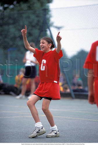 A girl celebrates on court, Mixed Netball, London Mini Games, Crystal Palace, 960711. Photo: Richard Francis/Action Plus....1996.funnies.funny.humour.humorous.laugh laughs laughter.celebrations celebration celebrate joy celebrating.child.children.kids.boy.boys.teenager.teenagers.youth.youths.Youngster.Youngsters.girls.girl.childrens sport.children's sport.40MB