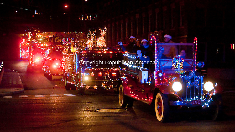 WINSTED, CT--- -121915JS07--Decorated fire trucks make their way across Main Street onto Elm Street as they make their way past during the 11th annual Winsted Fire Department &quot;Gator&quot; Christmas Parade on Saturday. The parade continues to honor the tradition of former firefighter Gaeton &quot;Gator&quot; Gangi who started the parade in 2004 as a community Christmas parade. <br /> Jim Shannon Republican-American