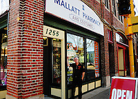 Owner of Mallatt Pharmacy and Costume, Mike Flint, poses in front of his new Williamson Street location in Madison, Wisconsin on Wednesday, October 13, 2010