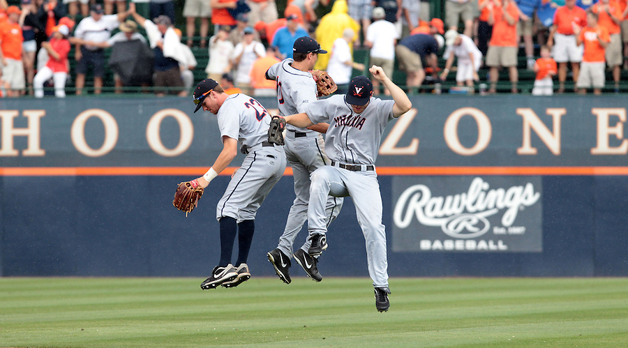 From left, Virginia outfielder Derek Fisher (23), Virginia outfielder Brandon Downes (10) and Virginia outfielder Joe McCarthy (31) celebrate the 7-3 win over Maryland after an NCAA college baseball tournament super regional game in Charlottesville, Va., Sunday, June 8, 2014. (AP Photo/Andrew Shurtleff)