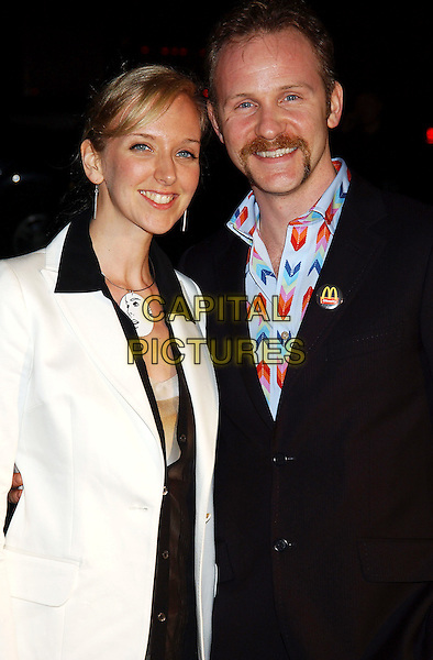 ALEXANDRA JAMIESON & MORGAN SPURLOCK.Global Green For Clean Energy Solutions Pre-Oscar Party Supporting The Fight Against Global Warming held at the Day After Club. Hollywood, California.February 24th, 2005.Photo Credit: Laura Farr/AdMedia.half length fiance badge pin McDonalds necklace goatee facial hair.www.capitalpictures.com.sales@capitalpictures.com.© Capital Pictures.