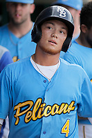 Myrtle Beach Pelicans D.J. Wilson (4) being congratulated in the dugout during a game against the Potomac Nationals at Ticketreturn.com Field at Pelicans Ballpark on July 1, 2018 in Myrtle Beach, South Carolina. Myrtle Beach defeated Potomac 6-1. (Robert Gurganus/Four Seam Images)
