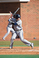 Jake Hall (18) of the UNCG Spartans at bat against the High Point Panthers at Willard Stadium on February 14, 2015 in High Point, North Carolina.  The Panthers defeated the Spartans 12-2.  (Brian Westerholt/Four Seam Images)