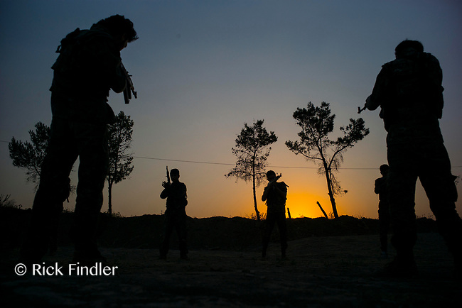 August 2017. Rojava, Syria.<br /> New recruits go through training at an MFS academy in Al-Hasakah, norther Syria. All the new intake do not necessarily fight once they graduate, but go on to perform tasks such as further training, further education and logistics. <br /> The MFS are a group of Assyrian Christians who fight alongside the Syrian Democratic Forces in the fight to topple ISIS.<br /> Photographer: Rick Findler