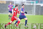 Dingle Bay Rovers Eoin Murphy and Carndonogh FC's Matthew Byrne.