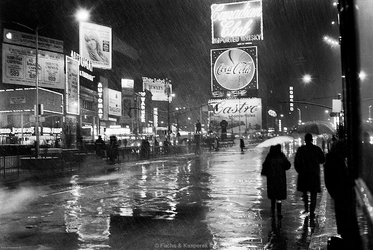 A rainy Times Square is nearly empty a few hours before midnight on New Years Eve, 1967.