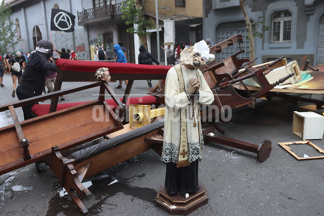 Rioters rising Anarchist flags looted, destroyed and set on fire the Asuncion church in dowtown Santiago, in another day of violence in Chile.