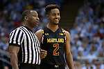 01 December 2015: Maryland's Melo Trimble (2) with referee Michael Roberts. The University of North Carolina Tar Heels hosted the University of Maryland Terrapins at the Dean E. Smith Center in Chapel Hill, North Carolina in a 2015-16 NCAA Division I Men's Basketball game. UNC won the game 89-81.