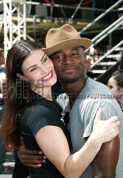 Idina Menzel ( WICKED ) and her husband Taye Diggs<br /> attending The 12th Annual Toys R Us presents BROADWAY ON BROADWAY Free Concert in Times Square, New York City. <br /> September 7, 2003