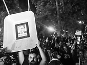Warsaw July 21, 2017 Poland<br /> People shout slogans during a protest against supreme court legislation outside the Parliament in Warsaw. A man holds a cart with a pasted image of Poland's Minister of Justice Zbigniew Ziobro<br /> Photo: Adam Lach / Napo Images<br /> <br /> Warszawa, Protest przed Senatem w obronie sadu najwyzszego. Tysiace ludzi zebranych pod oknami senatu, manifestowalo przeciwko wprowadzanej uchwaly wsp sadu najwyzszego. N/Z mezczyzna z wizerunkiem Ministra Sprawiedliwosci Zbigniewa Ziobro na taczce<br /> Fot: Adam Lach / Napo Images