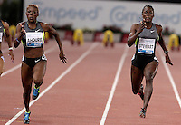 L'ivoriana Murielle Ahoure vince i 100 metri donne durante il Golden Gala di atletica leggera allo stadio Olimpico di Roma, 31 maggio 2012. A destra, la giamaicana Kerron Stewart..Ivory Coast's Murielle Ahoure runs to win the women's 100 meters during the IAAF athletic Golden Gala meeting at Rome's Olympic stadium, 31 may 2012. At right, Jamaica's Kerron Stewart..UPDATE IMAGES PRESS/Riccardo De Luca