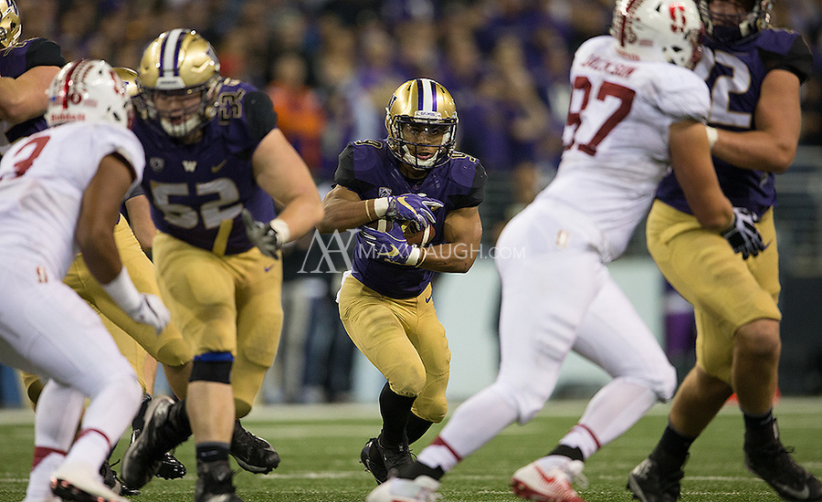 Myles Gaskin looks for a hole.