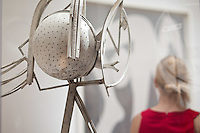 'Tete de femme', Head of a Woman, sits to the left while Tara (right) examines The Acrobat by Picasso during SAM Remix on Saturday, Nov. 13, 2010.