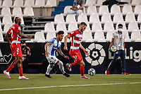 22nd June 2020; Estadio Municipal de Butarque, Madrid, Spain; La Liga Football, Club Deportivo Leganes versus Granada; Domingos Duarte (Granada CF)  holds up the ball as Guerrero of Leganes challenges