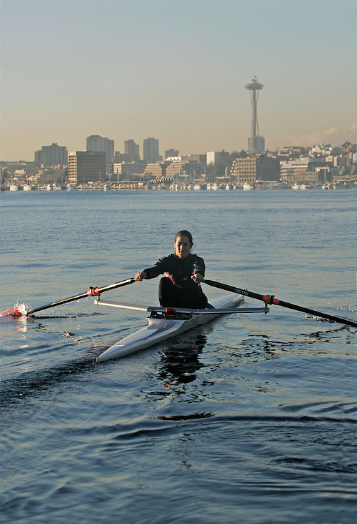 Rowing, Olympic-caliber Woman rower in single racing shell, Pocock Rowing Foundation, Lake Union, Seattle, Washington State, Pacific Northwest, USA,.