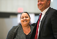 NWA Democrat-Gazette/CHARLIE KAIJO Hon. Thomas Smith (from right) hugs graduate Pamela Creech during the Adult Drug Court and Veterans Treatment Court graduation, Friday, June 8, 2018 at the Church of Christ in Bentonville. <br /><br />Some participants in Benton County&acirc;&euro;&trade;s drug and veterans court graduated from the program, their largest class. A ceremony was held Friday and Lt. Governor Tim Griffith was the guest speaker.