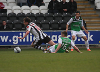 Lewis Stevenson fouls Paul McGowan to pick up his 2nd booking in the St Mirren v Hibernian Clydesdale Bank Scottish Premier League match played at St Mirren Park, Paisley on 29.4.12.