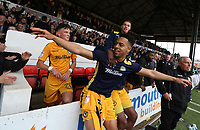 Jazzi Barnum-Bobb of Newport County celebrates after the final whistle as a late goal from Mark O'Brien secures safety for Newport to stay in League two during the Sky Bet League Two match between Newport County and Notts County at Rodney Parade, Newport, Wales, UK. Saturday 06 May 2017