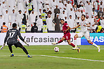 Hamid Ismaeil Khaleefa of Qatar (R2) attempts a kick for a goal against Goalkeeper Khalid Eisa Bilal of United Arab Emirates (L) during the AFC Asian Cup UAE 2019 Semi Finals match between Qatar (QAT) and United Arab Emirates (UAE) at Mohammed Bin Zaied Stadium  on 29 January 2019 in Abu Dhabi, United Arab Emirates. Photo by Marcio Rodrigo Machado / Power Sport Images