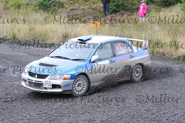 Barry Groundwater - Neil Shanks at Junction 3 on Special Stage 4 J & B Print Arroch Hill of the GWF Energy Merrick Stages Rally 2013, Round 7 of the RAC MSA Scotish Rally Championship which was organised by Machars Car Club and Scottish Sporting Car Club and based in Wigtown on 7.9.13.