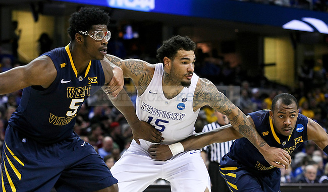Willie Cauley-Stein of the Kentucky Wildcats fights for a rebound during second half of the Sweet 16 of the 2015 NCAA Men's Basketball Tournament against the  at Quicken Loans Arena on Thursday, March 26, 2015 in Cleveland , Ky. Photo by Jonathan Krueger | Staff.