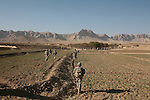 U.S. soldiers with Company C, 4th Battalion, 23rd Infantry Regiment walk across a field during a clearing operation in the Shah Joy district of southern Afghanistan's Zabul province. Oct. 25, 2010. DREW BROWN/STARS AND STRIPES
