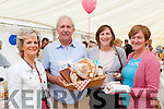Baker Jack Healy offers Catherine McGrath, Mary Clifford and Rosarie McGillicuddy some of his produce at the Killorglin business expo in the Killorglin CYMS on Friday