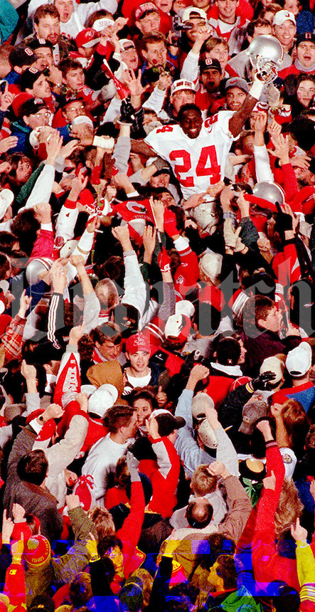 Shawn Springs (24) of Ohio State is carried off the field by fans after the Buckeyes' 27-17 victory over Indiana Nov. 16, 1996. The win sends OSU to the Rose Bowl for the first time since the 1985 game. (Columbus Dispatch by Mike Munden)
