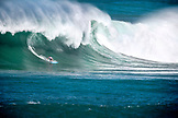 USA, Hawaii, surfer riding a large wave on the North Shore, Eddie Aikau surfing competition, Waimea Bay