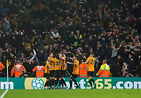 27th December 2019; Molineux Stadium, Wolverhampton, West Midlands, England; English Premier League, Wolverhampton Wanderers versus Manchester City; Matt Doherty of Wolverhampton Wanderers celebrates with his team after scoring to take the lead 3-2 in the 89th minutes of the match - Strictly Editorial Use Only. No use with unauthorized audio, video, data, fixture lists, club/league logos or 'live' services. Online in-match use limited to 120 images, no video emulation. No use in betting, games or single club/league/player publications - Strictly Editorial Use Only.