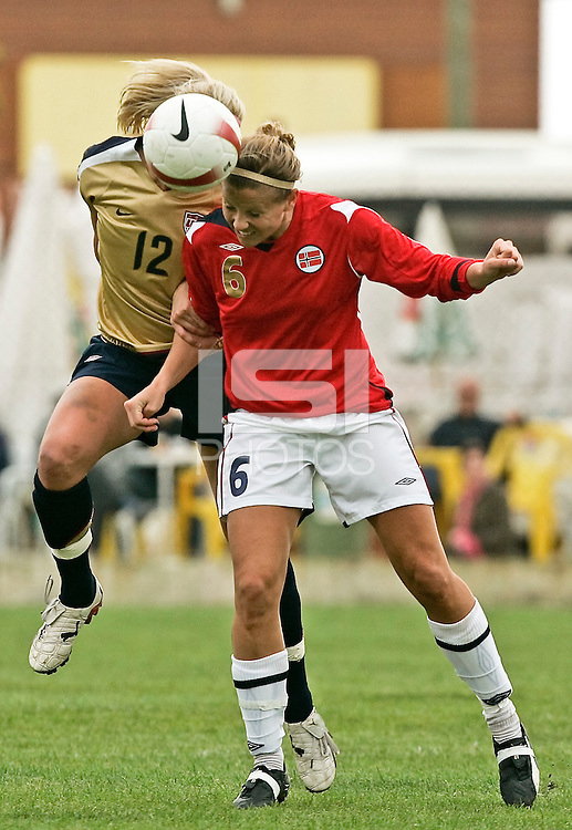 USA´s Leslie Osborne fights for the ball with Norway´s Marie Knutsen. The United States defeated Norway 4-0 during an Algarve Cup Group B match at Restinga Stadium in Alvor, Portugal on March 10, 2008. Paulo Cordeiro/isiphotos.com