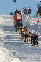 Jessie Holmes on Cordova St. hill during the Anchorage start day of Iditarod 2018 on Cordova St. hill during the Anchorage start day of Iditarod 2019