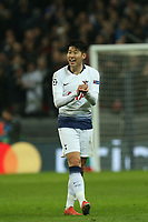 Son Heung-Min of Tottenham Hotspur smiles as he's substituted during Tottenham Hotspur vs Borussia Dortmund, UEFA Champions League Football at Wembley Stadium on 13th February 2019