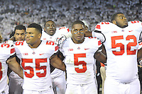 25 October 2014:  Ohio State LB Cam Williams (55), LB Raekwon McMillan (5), and DL Donovan Munger (52) sing Carmen Ohio after the game. The Ohio State Buckeyes defeated the Penn State Nittany Lions 31-24 in 2 OTs at Beaver Stadium in State College, PA.