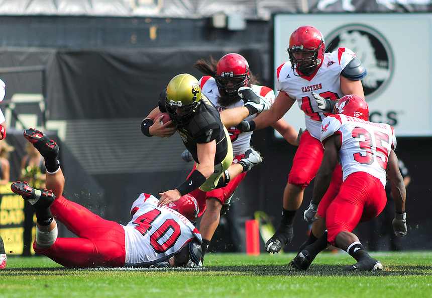06 September 08: Colorado quarterback Cody Hawkins (in black) is tripped up by Eastern Washington safety Matt Johnson (40) on a quarterback keep play. The Colorado Buffaloes defeated the Eastern Washington Eagles 31-24 at Folsom Field in Boulder, Colorado. FOR EDITORIAL USE ONLY