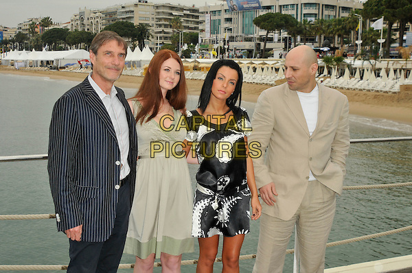 "ROLAND JOFFE, LENA KATINA, YULIA VOLKOVA & IGOR DESYATNIKOV - t.A.T.u..""You and I"" photocall.Majestic Hotel pier.61st Cannes International  Film Festival, France.16th May 2008 .tatu half length black pinstripe suit jacket dress white pattern green beige .CAP/PL.© Phil Loftus/Capital Pictures"