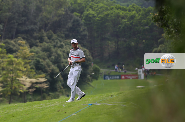 Michael Hoey (NIR) has a difficult lie on the edge of the 13th fairway but is 6 shots to the good (-12) and making a charge on the leaders during the Final Round of the 2014 Volvo China Open, Genzon Golf Club, Shenzhen, China. Picture:  David Lloyd / www.golffile.ie